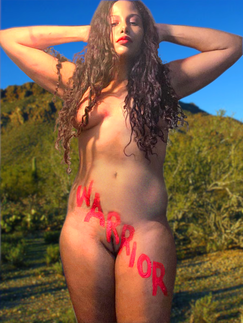 Warrior: a nude woman with the word 'warrior' painted on her